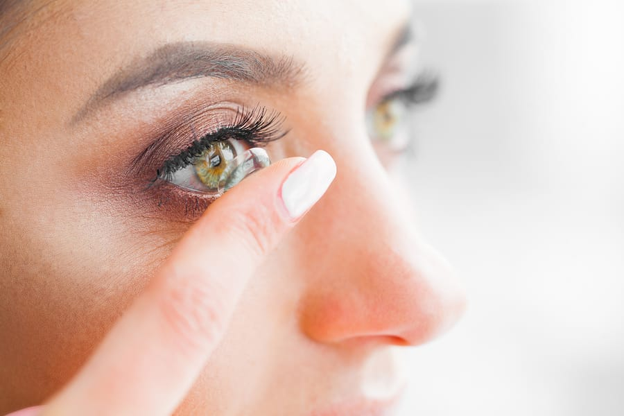 Woman Putting Contacts into Eyes