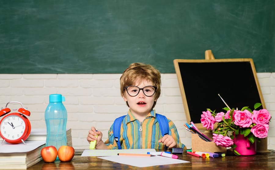 Boy in glasses in classroom